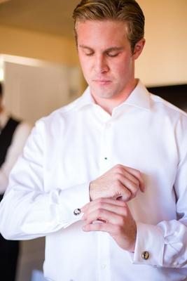 groom fixing cufflinks wedding la jolla san diego california white shirt formal beachy la valencia