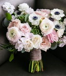 wedding bouquet anemone ranunculus rose ribbon around green stems succulents