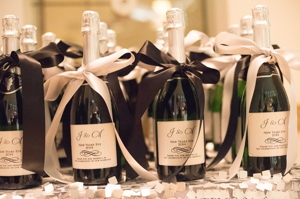 Custom labels on sparkling wine bottle favors