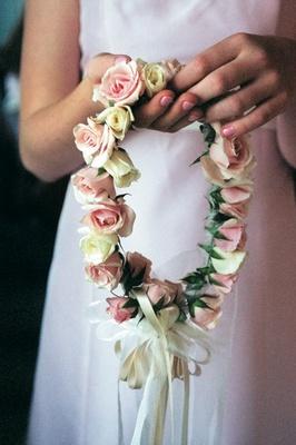 Flower girl holding her floral crown