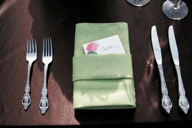 Brown tablecloth with green linen napkin and name card