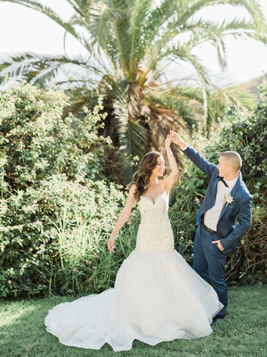 Bride in trumpet wedding dress mermaid groom in navy blue suit black bow tie