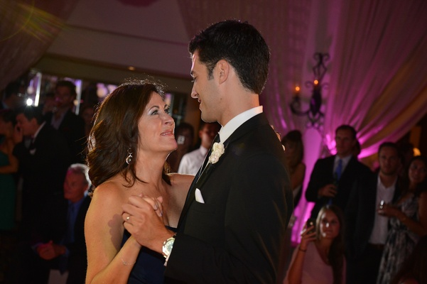 Emotional mother and groom dance at wedding reception