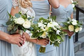 Bride in jewel wedding dress bridesmaids in light blue dresses bouquet greenery fern leaf white rose