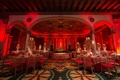 Ruby lights covering gold tables and chairs