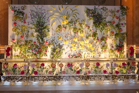 Wedding decoration wall covered with flowers greenery ice sculpture with bright flowers frozen insid