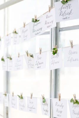 wedding reception twine with esocrt cards leaves miniature clothespins on line greenhouse