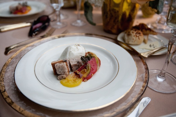 Burrata and heirloom tomatoes on fine china plate