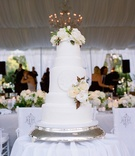 White five layer cake with fresh flower cake topper