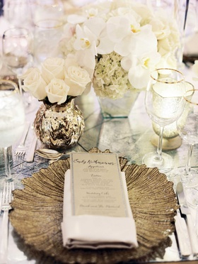 Wedding menu with Laura Hooper Calligraphy on gold pattern charger plate with gold mercury glass