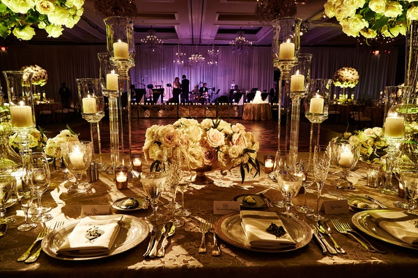 Wedding reception table texture linens candleholders acrylic lucite with purple lighting band stage
