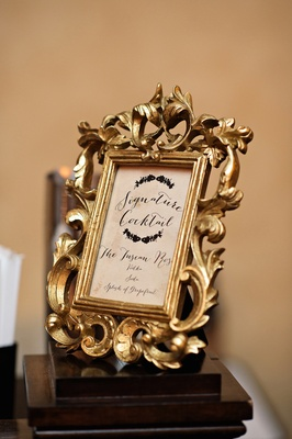Wedding reception with cocktail listed in a ornate gold frame