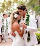 Bride and groom dancing outside in Hawaii