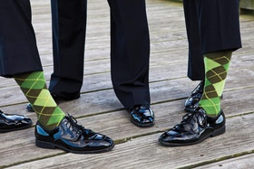 Groomsmen in shiny patent leather shoes and green golf socks