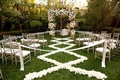 White flower chuppah with petal aisleway on grass lawn