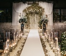 former miss america savvy shields pretty white and greenery wedding ceremony altar drapery flowers