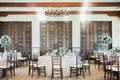 Bel-Air Bay Club wedding reception ballroom dark wood chairs doors high low centerpieces neutral