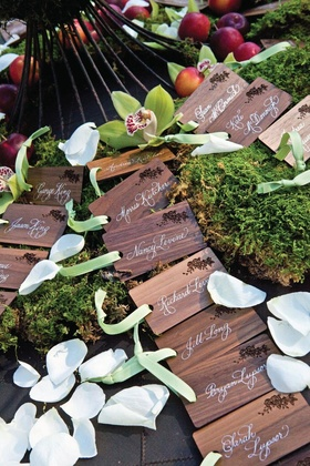 Engraved wood escort cards with white calligraphy