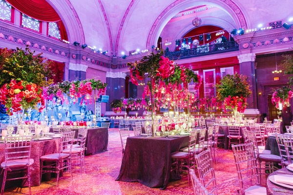 Summer wedding with vibrant color palette in brooklyn inside weylin b seymours wedding reception with pink purple and greenery decorations with uplighting junglespirit Choice Image