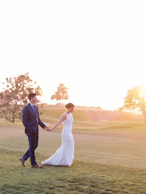 the lodge at torrey pines wedding portraits on golf course trees sun setting walking on grass