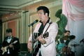 Elvis Presley wedding singer in pink jacket