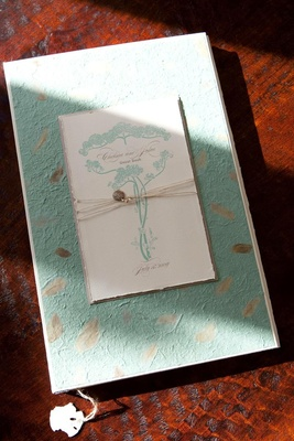 Turquoise handmade paper guestbook with art nouveau design
