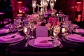 Silver centerpiece with purple lighting on reception table