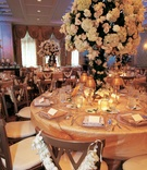 Gold tablecloths and tree centerpieces at The Townsend