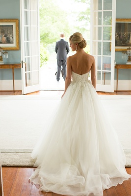 Back of bride wearing strapless bridal gown