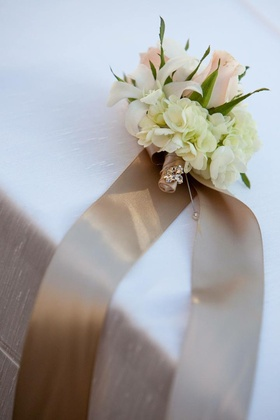 Champagne ribbon tied to neutral flowers