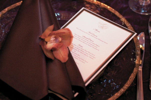 Dinner menu at wedding reception in gold and brown