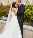 bride in strapless vera wang wedding dress long veil hair down groom in tuxedo suit washington dc