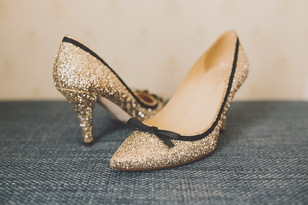 Gold and black Kate Spade wedding shoes.