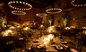 Brick building wedding reception with hundreds of candles