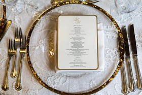 glass charger with gold rim and white menu with gold edge
