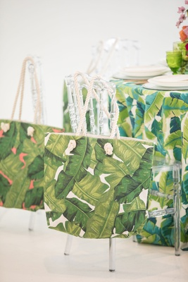 tropical wedding inspiration, banana leaf print tote bags, acrylic chiavari chairs