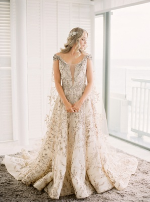 mariana paola vicente ecliptica atelier wedding dress embroidery champagne dress and cape hair down