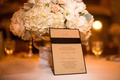 Wedding invitation in tan gold with a black ribbon