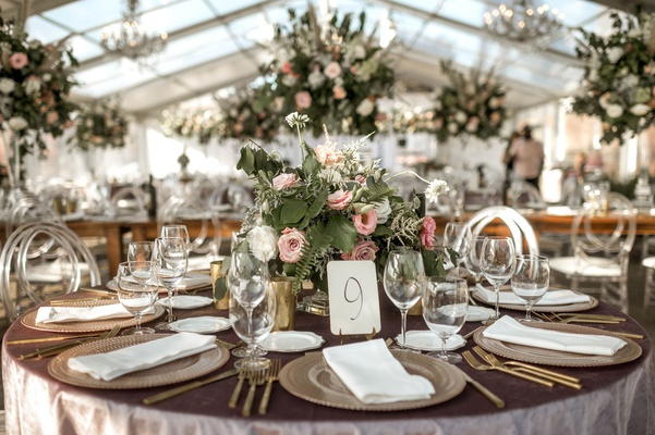 wedding reception clear tent round table and high low centerpieces chandeliers heatherlily
