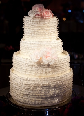 Four layer white round cake with sugar florals