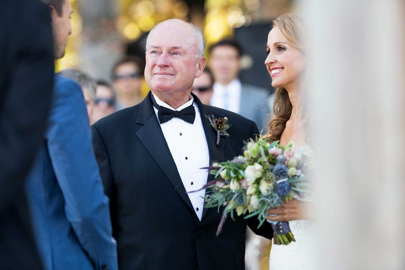 father of the bride gives away his daughter at wedding ceremony