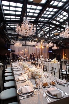 wedding reception revel motor row chandelier silver glitter linens low centerpiece crystal candles