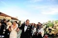 Bride and groom walk up aisle at outdoor wedding