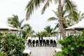 destination wedding groomsmen deck harbour island bahamas palm tree white tuxedo jackets