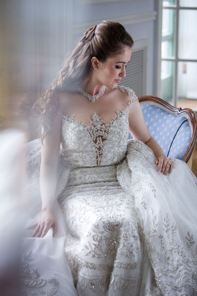 Beaded ball gown with large overskirt illusion neckline jewels cap sleeves embellishments beading