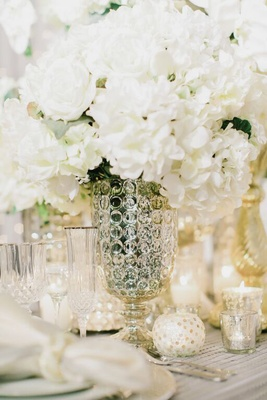 Mercury glass vase with white flowers at winter wedding reception
