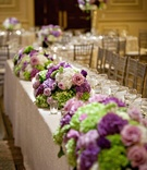 Bunches of purple and green flowers on tables
