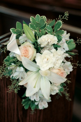 White flower arrangement on wedding church pews