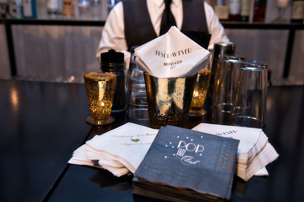 Wedding reception bar with personalized custom beverage napkins best day ever pop fizz clink