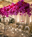 tall blossoms atop clear structure tablescape california wedding reception tropical unique colors